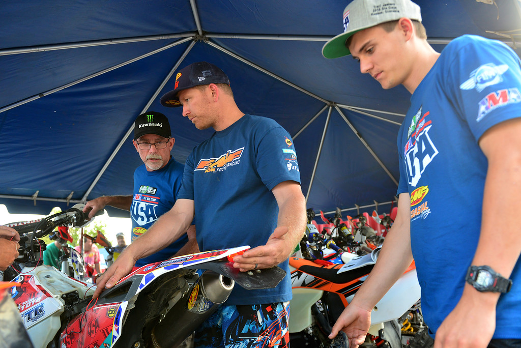 Tanner Harding and Jeff Fredette helping Josh work on his bike - photo by Art Pepin